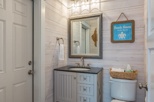 1-beach-cottage-bathroom-with-white-wood-walls 14 Beautiful Beach Cottage Bathroom Designs