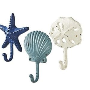 Sea-Treasures-Wall-Hooks-Set-of-3-Antique-Weathered-Hangers-for-Coats-Aprons-Hats-Towels-Pot-Holders-Scallop-Sand-Dollar-Sea-Star-Starfish-0-300x300 38 Of Our Favorite Beach Wall or Towel Hooks