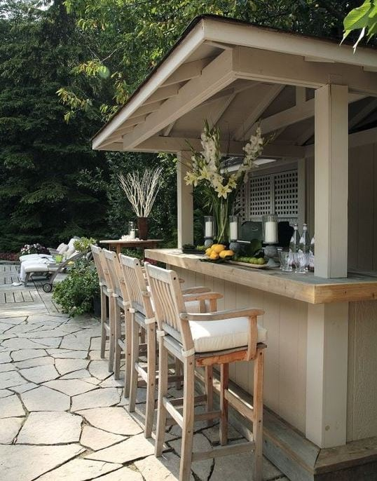 Outdoor-Oasis-by-Jackie-Glass-Inc-and-Robin-Stubbert-Photography 51 Teak Outdoor Furniture Ideas