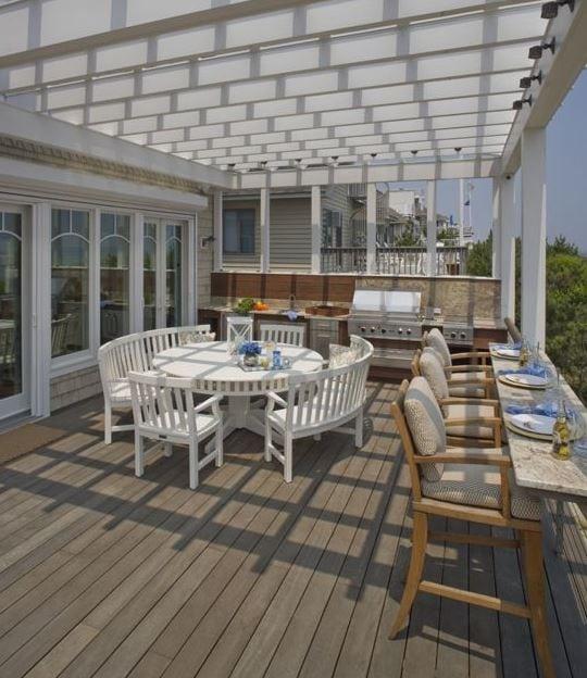 Waterfront-Retreat-by-Bruce-Palmer-Interior-Design 51 Teak Outdoor Furniture Ideas