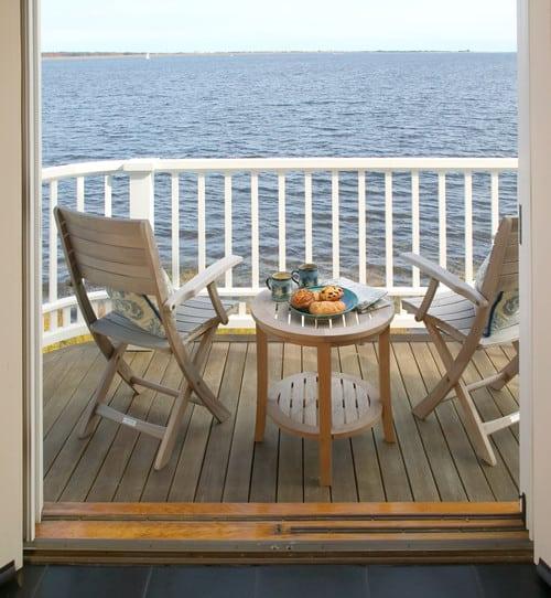 traditional-balcony 51 Teak Outdoor Furniture Ideas