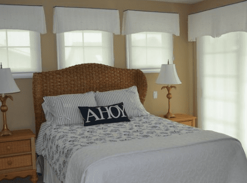 White-Navy-Guest-Bedroom-NJ-by-Erica-Kidwell-Interior-Design 101 Beach Themed Bedroom Ideas