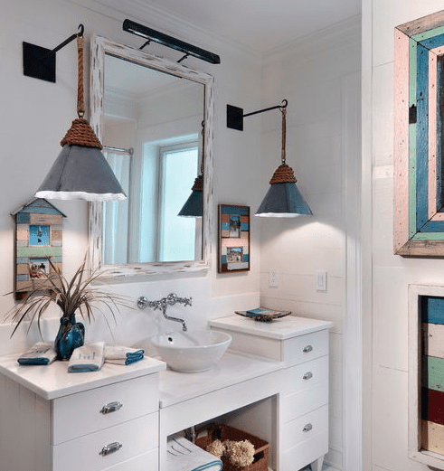 Beach-Cottage-by-Morales-Construction-Co.-Inc. Beach And Nautical Bathroom Lighting