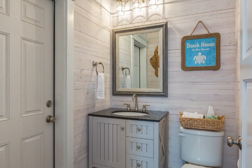 1-beach-cottage-bathroom-with-white-wood-walls 50+ Beach Cottage Bathroom Ideas