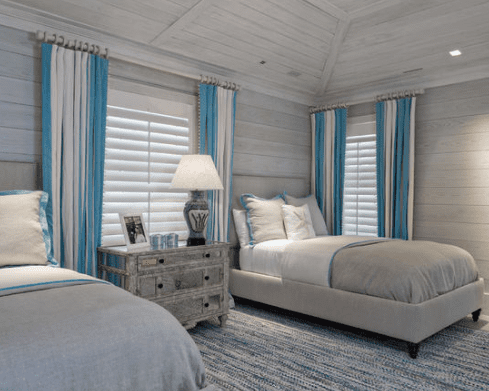 Beach-Style-Guest-Room-by-Keating-Moore-Construction 101 Beach Themed Bedroom Ideas