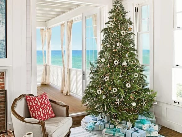 Tree-With-a-View-Photo-by-Jack-Gardner-Stylists-Linda-Hirst-and-Lynn-Nesmith 25+ Beach Christmas Tree Ideas 2020