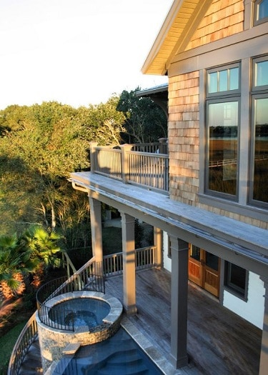 Beach-Cottage-Exterior-with-Pool-by-Sea-Island-Builders-LLC 50+ Coastal Cottages We Love