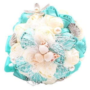 Abbie-Home-Beach-Wedding-Bridal-Bouquet-Holding-Tossing-Flower 100+ Beach Wedding Decorations and Ideas