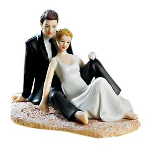 Weddingstar-Romantic-Wedding-Couple-Lounging-on-the-Beach-Figurine 100+ Beach Wedding Decorations and Ideas